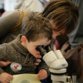 Mother and child looking through a microscope. c Victoria Haydn