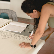 Woman writing on flipchart