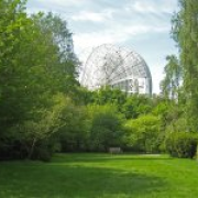 The Lovell Telecope behind the Jodrell Bank Arboretum