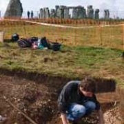 Archaeologists at work with Stonehenge in the background. Image c Bill Bevan