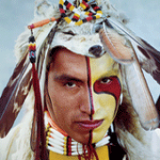 Returning the Gaze (detail). Assiniboine dancer Kevin Haywahe with face paint.