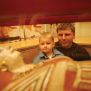 A father and son looking at an ancient Egyptian sarcophagus